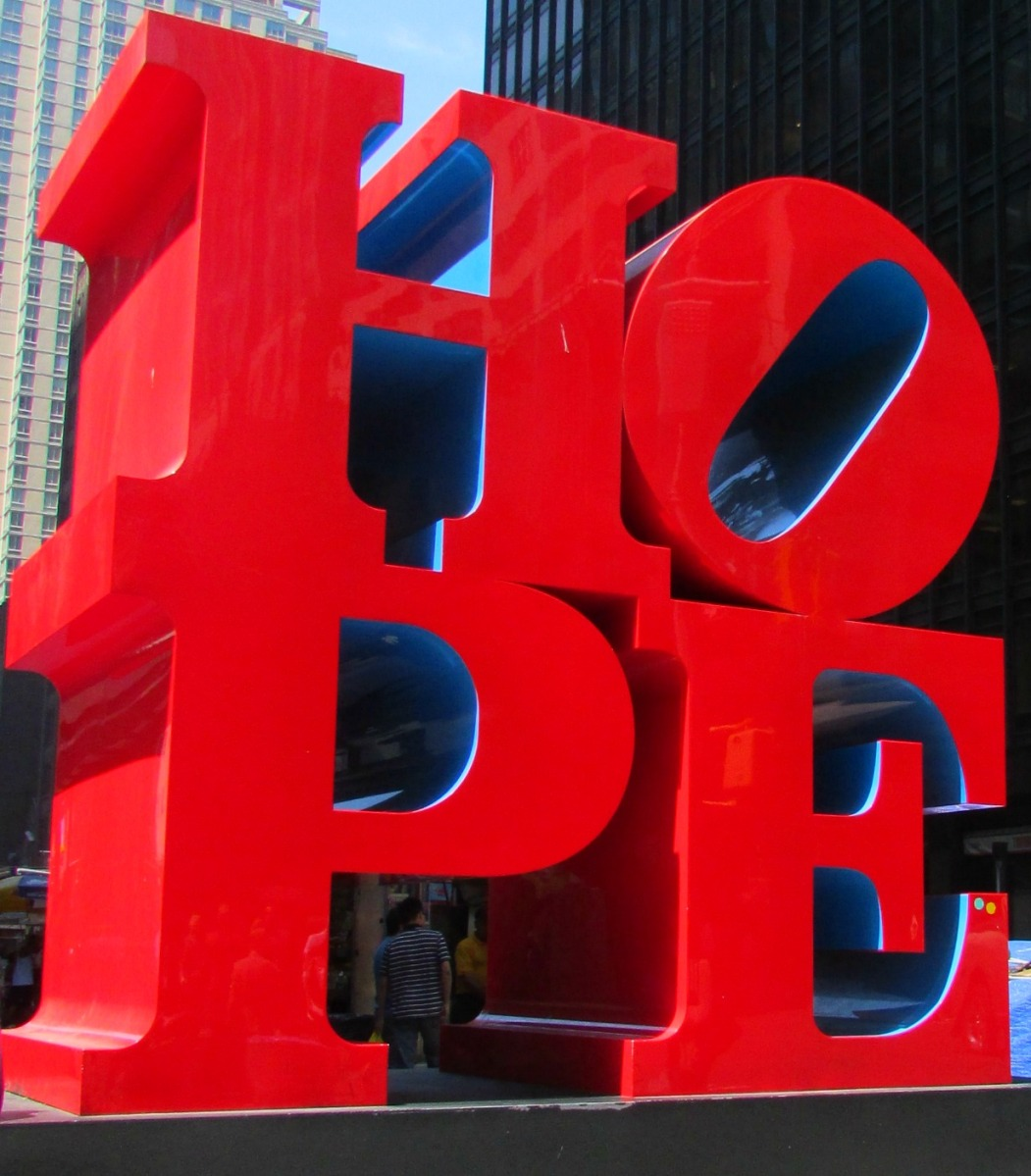 "NYC. Manhattan. Midtown. Robert Indianas ""HOPE red blue"" sign."